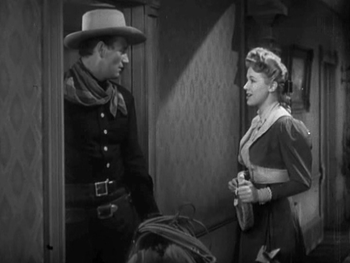 English: John Wayne and Audrey Long in Tall in...